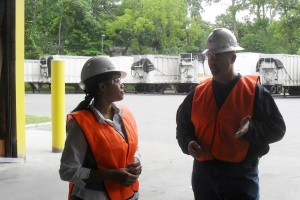 Plant Manager Dave Kahn making point to County Legislator Francena  Amparo