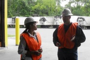 Plant Manager Dave Kahn making point to County Legislator Francena  Amparo