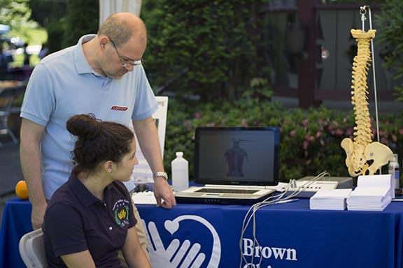 Brown Chiropractic checking blood pressure. Photo Credit: Travis Jones, Fortune Visuals